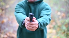 MAN IN WOODS POINTS GUN AT YOU Stock Footage
