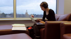 Pretty Blonde Female College Student Studying And Typing Near Urban Window View Stock Footage