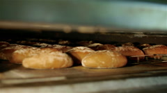 Take out the bread from the oven Stock Footage