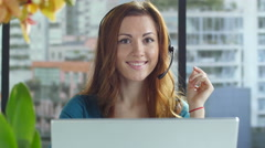 Portrait of a young female customer service representative - stock footage