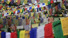 Colorful Buddhist prayer flags at temple in the Dharamsala, India Stock Footage