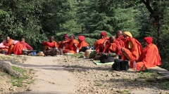 Tibetan men begging money on the road. Dharamsala, India Stock Footage