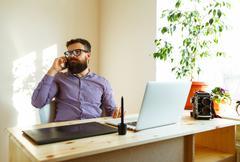 Beard man working from home - modern business concept Stock Photos
