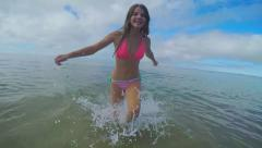 Athletic Teen Girl Runs Through Shallow Water And Past Camera, At Beach - stock footage
