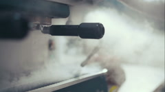 The coffee machine produces steam. Preparing to work Stock Footage