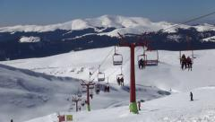Timelapse Skiers Riding Chairlift in Alps, Alpine, Winter Sports, Skiing Slope Stock Footage