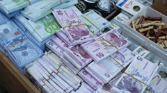 Fake money sold on street stall Stock Footage