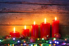 Red candles with Christmas ornament balls Stock Photos