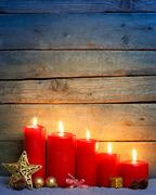 Red candles with Christmas ornament balls - stock photo