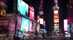 Times Square lit up at night in New York City 4k Stock Footage