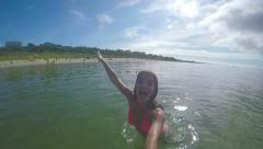 Teenage Girl Dives Underwater With Gopro Stick And Poses With A Thumbs Up Stock Footage