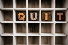 Stock Photo of Quit Concept Wooden Letterpress Type in Drawer