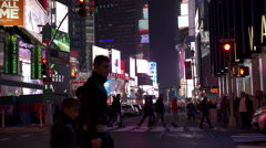 Traffic in Times Square with pedestrians crossing street 4k Stock Footage