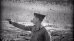 1934: Garrison cap solider practice shooting a Colt pistol gun with cigar. Stock Footage