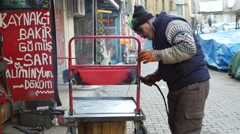 Man welds on the street in Istanbul Stock Footage