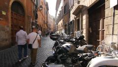Cobblestone street in Rome, Italy with tourists. Stock Footage