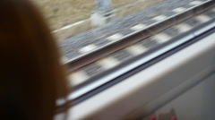 Passenger on the train looking at rails Stock Footage