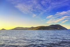 Stock Photo of Elba island morning view from ferry boat. Mediterranean sea. Italy