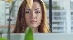 Young woman working at computer, extreme close up Stock Footage