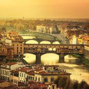 Florence or Firenze sunset Ponte Vecchio bridge panoramic view.Tuscany, Italy - stock photo
