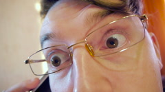 Crazy eye businessman in glasses Stock Footage