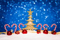 christmas ornament in snow on glitter background - stock photo