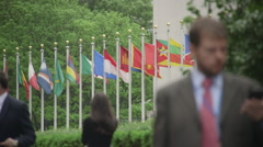 People walk in front of United Nations building in New York Stock Footage