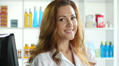 Portrait of a female pharmacist - stock footage