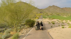 Golf Course Aerial - follow the golf cart Stock Footage
