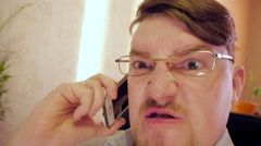 Very Angry Crazy eye businessman in glasses Stock Footage
