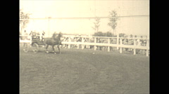 Vintage 16mm film, 1925, US Roaring 20s, horse buggy race Stock Footage