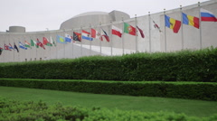 United Nations headquarters building in New York with flags Stock Footage