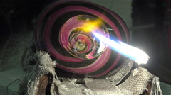 Glass-blower working in his workshop Stock Footage