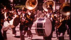 2962 - marching band in local town parade - vintage film home movie - stock footage