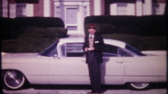 2964 - wealthy man & his Cadillac in front of mansion - vintage film home movie - stock footage