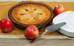 Stock Photo of Freshly baked homemade apple pie on table cloth