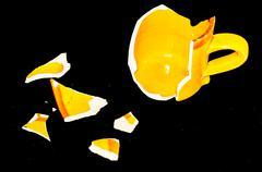 Broken Orange Coffe Cup Stock Photos