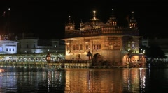 Sikhs and indian people visiting the Golden Temple in Amritsar at night. India Stock Footage