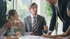 4K Corporate business team brainstorming for ideas in office meeting - stock footage