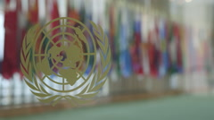 United Nations world globe logo and delegates Stock Footage