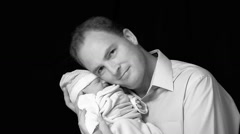 Father and Newborn Son - stock footage