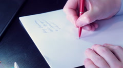 Businessman Male hands writing graphics on paper - stock footage