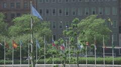 United Nations flag ion New York with traffic Stock Footage