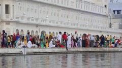 Sikhs and indian people visiting the Golden Temple in Amritsar, Punjab, India - stock footage