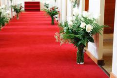 Red carpet in church for wedding ceremony Stock Photos