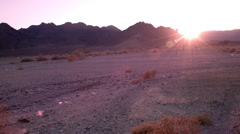 Red desert landscape pan lens flare Stock Footage