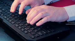 Businesman typing on keyboard close up Stock Footage