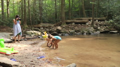 Kids Playing In Creek Stock Footage