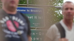 Welcome to Brooklyn sign with people - stock footage