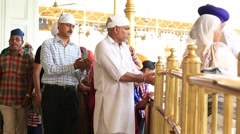Sikhs and indian people visiting the Golden Temple in Amritsar, Punjab, India Stock Footage